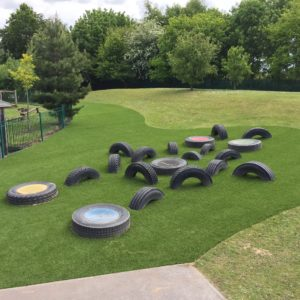 Tyres in artificial grass