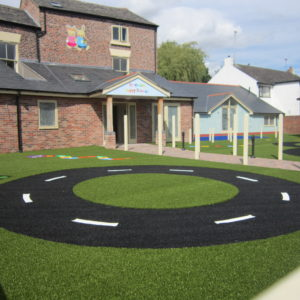 Roadway in black artificial grass