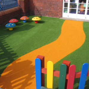 Yellow artificial grass pathway